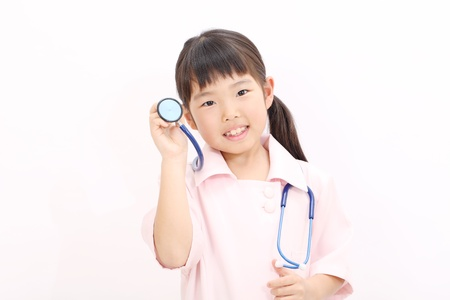 Shot of a little girl in a nurse uniform