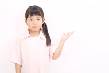 A little girl nurse rise hand showing blank sign photo