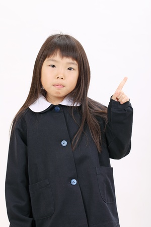 Little asian schoolgirl rise hand and pointing Stock Photo - 12937695