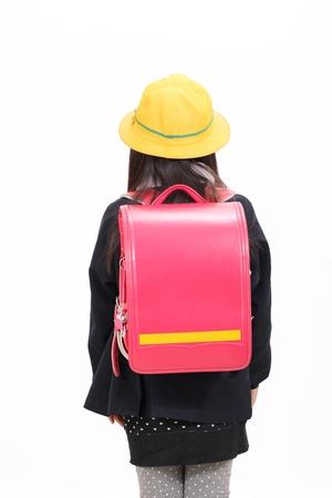 Little asian schoolgirl in school uniform, back view Stock Photo - 12937628