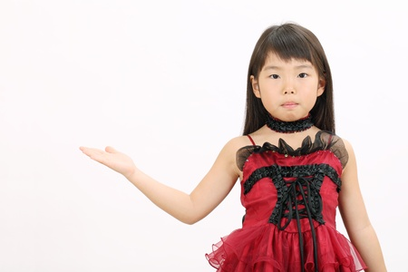 Little asian girl rise hand showing blank sign photo