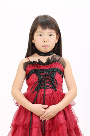 Little asian girl with hands crossed photo