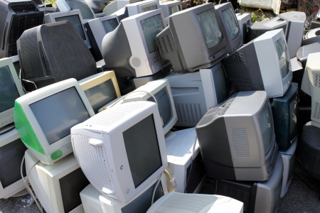 Piles of computer monitors for recycling