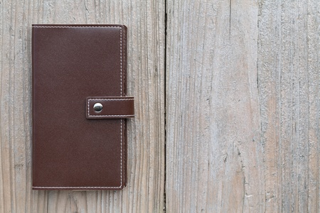Leather organizer on wooden table