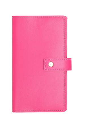 Pink leather covered book on white background photo