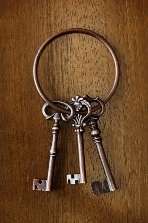 Antique key on wooden background photo