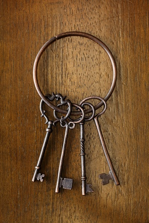 Old key on a wooden background Stock Photo - 13586887