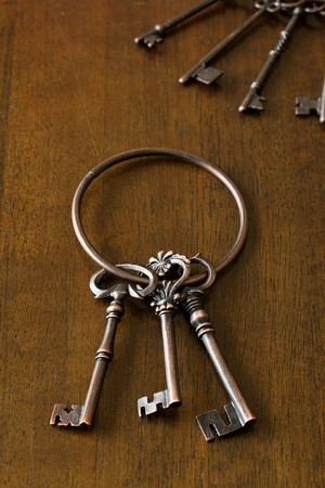 Old key on a wooden background photo