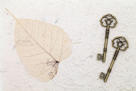 Antique keys on handmade rice paper photo