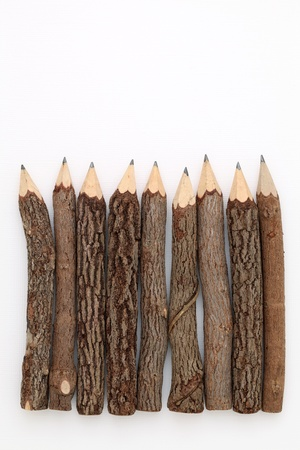 Wooden pencil on white background