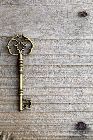 Antique key on wooden table  Stock Photo - 13983355