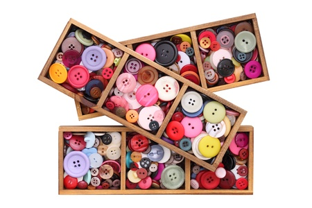 Colorful buttons in wooden box photo