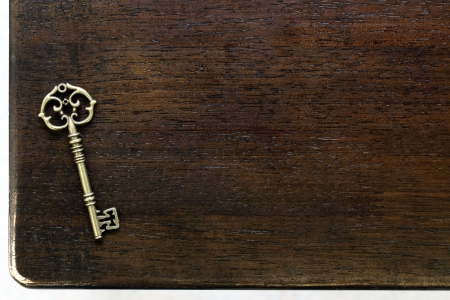 Antique key on wooden table photo