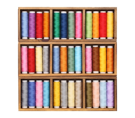 Colorful threads in wooden box  photo
