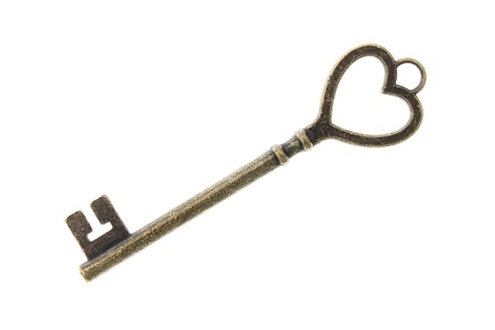 Antique key isolated on white background photo
