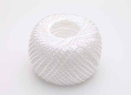 pp: Ball of nylon rope on white background Stock Photo