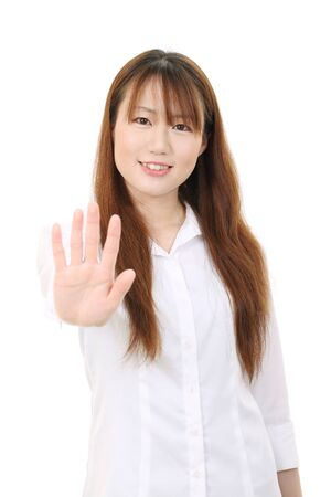 disallow: Young asian businesswoman showing her hand