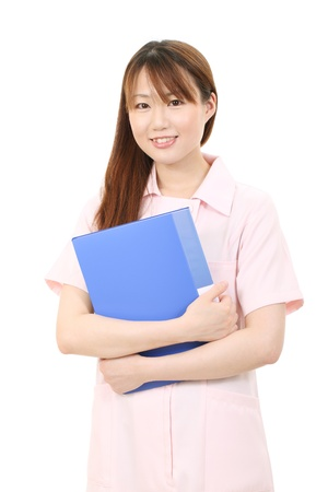 Young asian female nurse holding a file photo