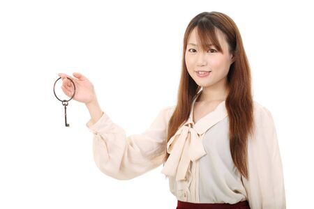 Young asian woman holding a antique key photo