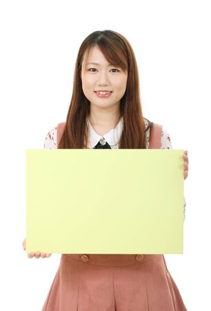 Young asian woman holding blank board photo