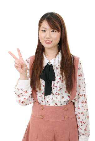Happy young asian woman showing the peace sign  photo