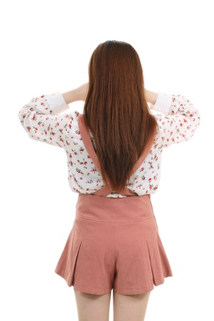 Crying standing young girl, back view photo
