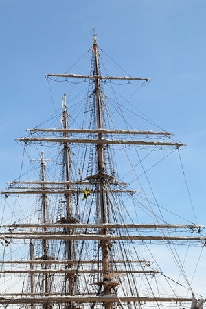 Rigging of big sailing ship against a blue sky photo