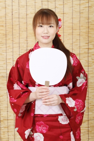 Young asian woman in clothes of kimono  photo