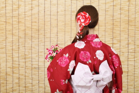 Back view of young asian woman in clothes of kimono photo