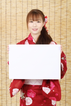 Young asian woman of kimono holding a blank white board  photo