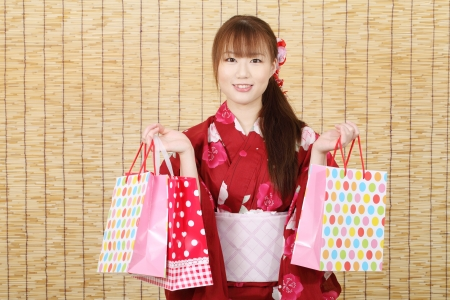 Young asian woman in clothes of kimono with shopping bag  photo