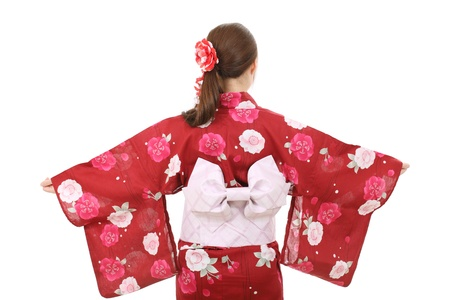Young asian woman in clothes of kimono, back view photo