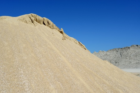 sand quarry: Brown sand mound against sky