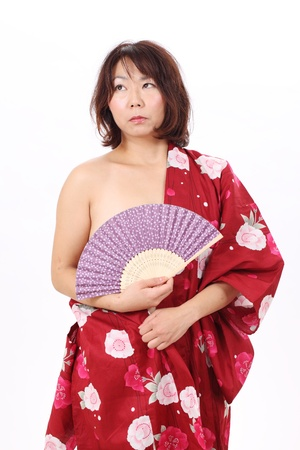 Portrait of naked woman in kimono with paper fan photo