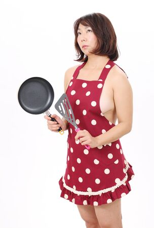 Sexual woman in apron with frying pan photo
