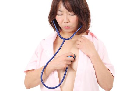 Portrait of asian female nurse with stethoscope Stock Photo - 16151562