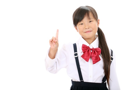 Smiling little asian girl rise hand and pointing photo