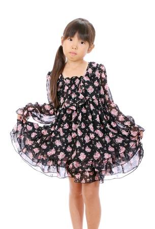 Picture of little asian girl holding skirt