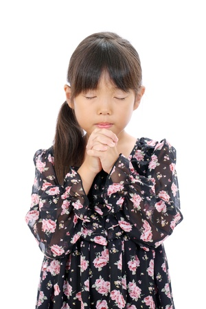 Portrait of little asian girl praying photo