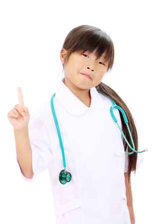 Portrait of little asian girl nurse pointing  photo