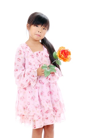 Little asian girl holding a rose on white background photo