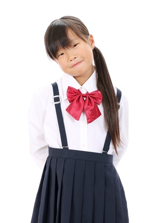Portrait of smiling little asian schoolgirl  Foto de archivo