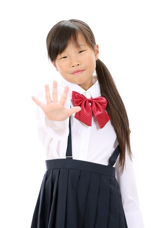 Smiling little asian girl show NO gesture Stock Photo - 16299581