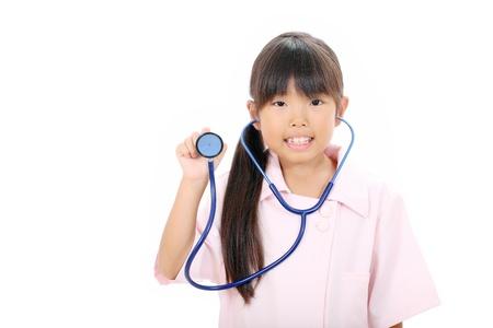 Little asian girl nurse showing a stethoscope Stock Photo - 16299564