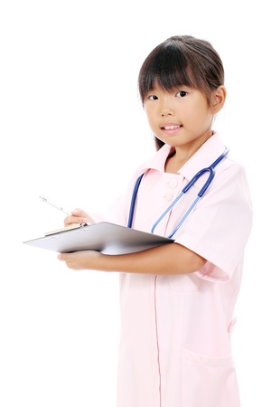 Portrait of little asian girl nurse holding a clipboard photo