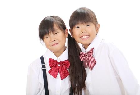 Little asian schoolgirls in school uniform  Stock Photo - 16334291