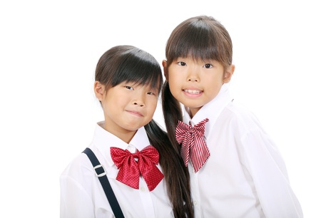 Little asian schoolgirls in school uniform  Stock Photo - 16334292