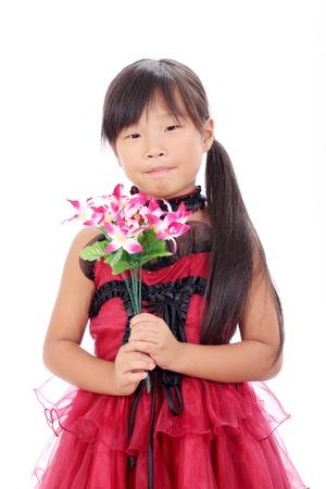 Photo of little asian girl holding flower Stock Photo - 16334300