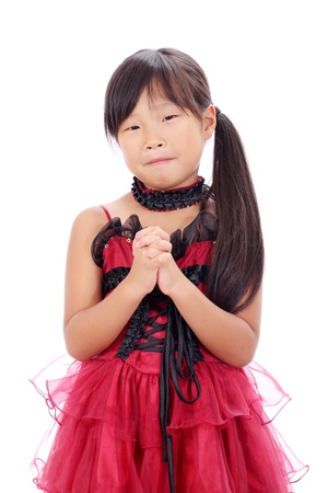 Studio photo of little asian girl praying  Stock Photo - 16334299