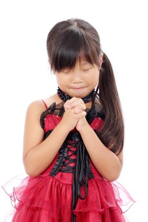 Studio photo of little asian girl praying  photo